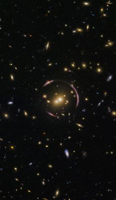 Astronomers using Hubble have spotted a so-called Einstein ring, a rare image of a distant galaxy lensed by gravity. This is an image of the gravitational lens system SDSS J0146-0929 as photographed by Hubble. Image credit: NASA / ESA / Hubble / Judy Schmidt, www.geckzilla.com