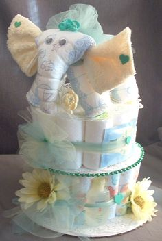 Yellow and Green Elephant Baby Shower Centerpiece diaper cake decoration made from baby diapers and washcloths. See more at http://www.judicakes.com/product/baby-elephant-baby-shower-centerpiece-diaper-cake-decoration-gift