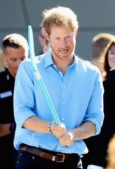 Prince Harry plays street hockey as part of the Streetsport initiative during a visit to Robert Gordon University on September 20, 2016 in Aberdeen, Scotland.
