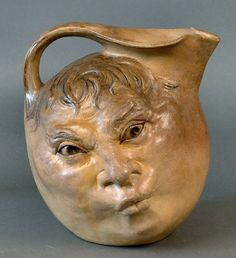 Martin Brothers Stoneware Pottery Double face jug by Robert Wallace Martin IMHO this is one of the top three best face jugs