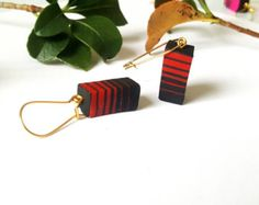Abstract red polymer clay earring by SufJewelery on Etsy