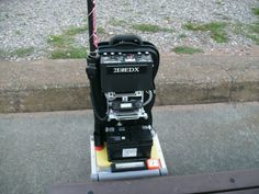 he HF /Pedestrian Mobile trolley shown in the photograph on the left combines a full size 1/4 wave vertical antenna with a 'Top Hat', using the MFJ-934 Ground Tuning Unit with no radials, FT-857, 12V 60AHr battery (800×600)
