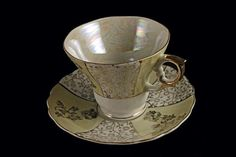 Hey, I found this really awesome Etsy listing at https://www.etsy.com/listing/236695549/teacup-and-saucer-enesco-opalescent