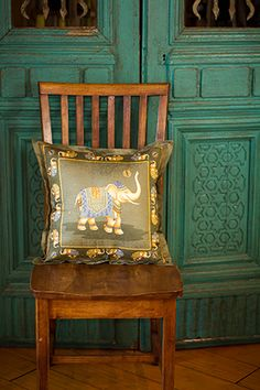 "This 18"" x 18"" olive green elephant Jim Thompson cushion cover was designed and made in Thailand."