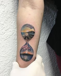 Hourglass beach side view  sands drops down as snow in top of a mountain view  tattoo