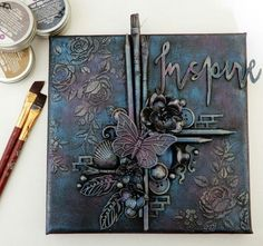 mixed media canvas-embellishments,black gesso and finnabair metallique waxes