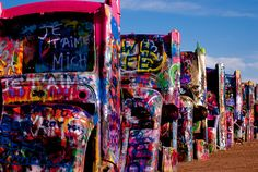 Cadillac Ranch in Amarillo, TX.  Bring your spray paint because graffiti is encouraged! Read more: http://blog.tourtexas.com/2015/06/24/amarillos-quirkiest-landmark-cadillac-ranch/
