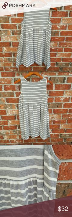 hug Gray & Cream Striped Dress Super super cute for the spring and summer with your fave pair of sandals!!  Only been worn once or twice, no signs of wear! Kind of had an elastic band at the waist and is very very flowy.   Size medium  ALL reasonable offers accepted Next business day shipping hug Dresses Mini