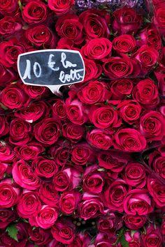 Gorgeous crimson roses at a Paris market.