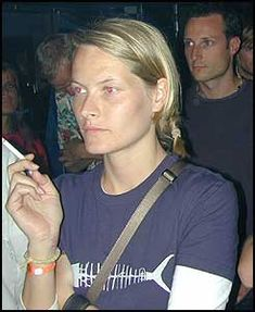 Mette-Marit with a cigarette in his hand. Yes, Haakon in the background.