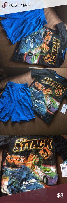 Boys pajama set with shorts Disney Pixar Cars pajama set. It has a black shirt with blue shorts with black stripe down the leg. Disney Pajamas Pajama Sets