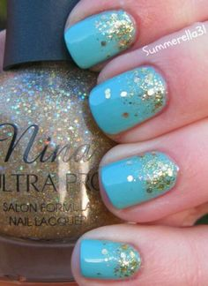 Bright baby blue and gold speckled nails