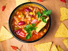 Beef, tomato, and chili powder, the very ingredients used to stuff a taco, are at the heart of this savory main-dish soup, which lends itself to numerous garnishes. From The New Atkins Made Easy.