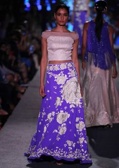Model walks the ramp in purple lehenga with rose motif for Manish Malhotra Blue Runway collection at Lakme Fashion Week Summer Resort 2015