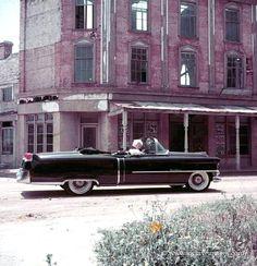 Milton Greene, Marilyn Monroe, black coat sitting