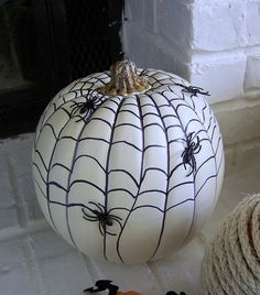 Pumpkin idea: Web drawn with a sharpie and glued spiders from rings