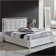 "Dupen Coco Queen Size Storage Bed in White - This bedroom collection offers an elegant blend of traditional elements with modern simplicity of lines that produces a unique and rich flair perfect for any contemporary bedroom. The collection oozes a luxurious Hollywood chic that you can bring and enjoy in your own private haven.    Features: Storage compartment under bed Made in Spain  Specifications: Product Weight: 300 lbs Overall Product Dimensions: 47""H x 69""W x 85""D"