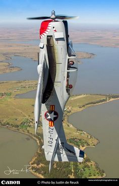..._Going Upstairs    Larry Beamish in the T-28 Trojan over the Vaal dam.