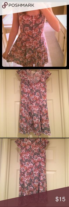 Comfy cute flowered dress Background color is greenish gray, with burgundy and cream roses. Has string so you can adjust the tightness around the waist. Buttons in front are fake. No tags but never worn! 65% polyester, 32% rayon, 3% spandex. PacSun Dresses