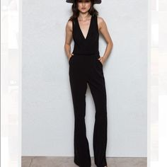 Theory black fitted tank jumpsuit Fitted jumpsuit w/ slack style pants that reach below ankles. Would probably look better on someone who was a bit smaller as it no longer fits me (I can't zip it up all the way in the back) Theory Other
