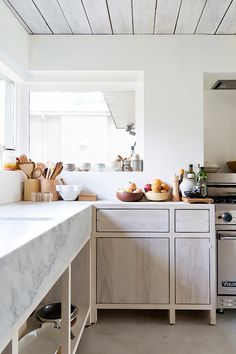 We prefer our wood kitchen cabinets with a matte finish and visible joinery. It gives this kitchen by Scott & Scott Architects an understated elegance that looks great against honed Carrara marble.