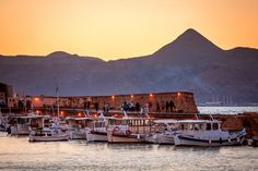 Travellers to Greece know that they shouldn't give the island of Crete a miss. Heraklion VS Chania is a common question for all tourists travelling to Crete Crete Heraklion, Santorini, Crete Greece, Island, Landscape, Country, City, Building, Mountain