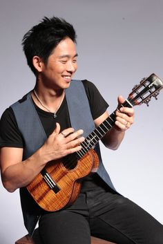 """Jake Shimabukuro. In his young career, ukulele wizard Jake Shimabukuro has already redefined a heretofore under-the-radar instrument, been declared a musical """"hero"""" by Rolling Stone, won accolades from the disparate likes of Eddie Vedder, Perez Hilton and Dr. Sanjay Gupta, wowed audiences on TV (Jimmy Kimmel, Conan), earned comparisons to Jimi Hendrix and Miles Davis, and even played in front of the Queen of England. jakeshimabukuro.com"""