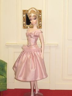 Lovely Pair, The second ensemble is a Moulin Rouge top in pale pink silk taffeta with a pale pink tulle ruffle at the hem, ruching at the bust, and a crystal belt buckle at the waist.  A dropped waist full skirt in the same pink taffeta has a pale pink tulle underskirt.