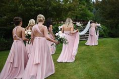 Petal pink tulle ballgowns| twobirds Bridesmaid multiway, convertible, twist wrap dresses | Photography: Amy Carroll Photography - amycarroll.photography/   Read More on SMP: http://www.stylemepretty.com/2016/10/14/greencrest-manor-summer-wedding/