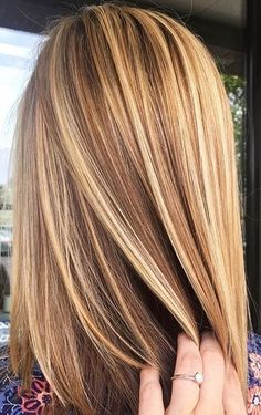Brown hair with blonde highlights. by jacqueline