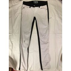 Back & White Skinny Jeans White front and black back skinny jeans. There's a tiny stain on the right knee, but it's not too bad. It also says the pants are a size 3, but they fit very tight and feel more like a size 1 Royal Bones Jeans Skinny
