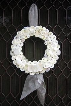 button wreath- if you are the proud owner of multitudes of unmatched buttons ( that would be me) you could do a color theme instead of white but very cool .