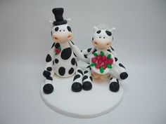 Hey, I found this really awesome Etsy listing at http://www.etsy.com/listing/109173891/polymer-clay-cow-wedding-topper