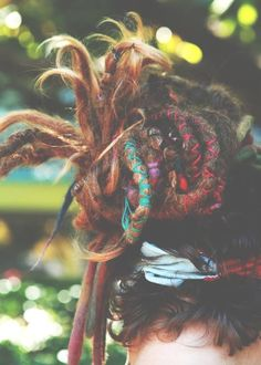 I saw a woman once with wrapped dreads like this - she also had charms and cool stuff - really a work of art!