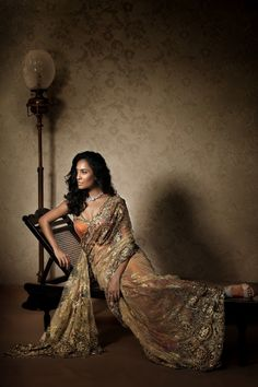 Gold Chantilly lace saree with orange bustier