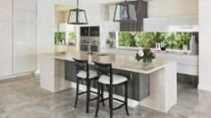 loving the kitchen with black instead of dark grey, green accent pops and greyer tint to tiles