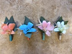 beachy orchid boutonnieres for a tropical feel