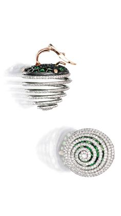 Pair of Platinum, Rose Gold, Silver, Demantoid Garnet and Diamond Earclips, JAR, Paris The spiraled motifs designed as springs, set with round diamonds weighing approximately 5.00 carats, on a ground of numerous round demantoid garnets, signed JAR.