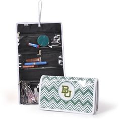 "Go Bears! Our new chevron striped amenity/ travel kit makes the perfect gift! Use it for make up, jewelry or our personal favorite, as a ""tail gate kit"" for your plastic forks, knives, napkins etc..its a game day essential! Features chevron stripes and clear vinyl exterior for easy clean up. Three large pockets with zipper closure for security and loop closure so you can  hang it up for easy accessibility. $24 www.desden.com"