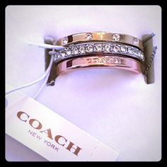 ✨COACH stackable ring set ✨Gorgeous COACH stackable ring set - size 7.  Includes 3 rings:  1 rose gold color with Coach engraved on it, 1 silver color with crystals all around (eternity band style), 1 yellow gold color with crystal accent stones spaced evenly around.  Brand new in box!  Very striking if worn together or on their own! Coach Jewelry Rings