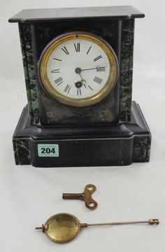 Lot 204 Victorian Slate Mantel Clock, marble inlays, white enamelled dial (KEY & PENDULUM IN OFFICE)
