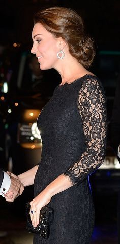 Barely there: Kate showed off a tiny bump...