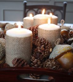 Burlap Candle Wrapped Centerpiece. What a great idea!!