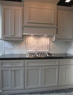 Grey Cabinets, White Subway Tile And Black Granite Counter Top