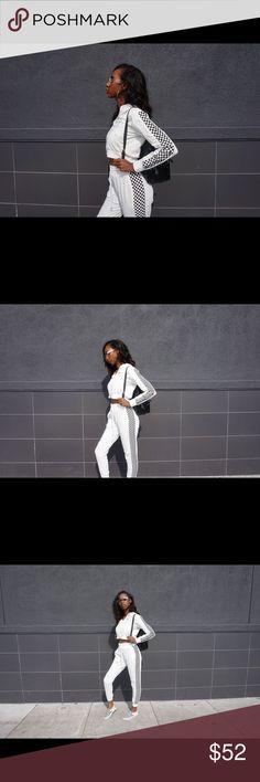 Checker Me Out Track Suit Description:  -Two Piece Set  -Includes Jacket and Pants  -Color: White  -Hooded Collar  -Pants Length: Ankel Lengh MK Boutique Tops Sweatshirts & Hoodies
