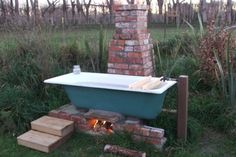 garten ideen Rocket stove tub - outdoors How Soundproofing Material Works Sound vibrations are trans Outdoor Bathtub, Outdoor Bathrooms, Indoor Outdoor, Camping And Hiking, Outdoor Camping, Outdoor Spaces, Outdoor Living, Water Pail, Materiel Camping
