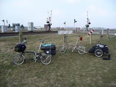 Bromptons plus baggage, two solutions by shanecycles.com, via Flickr