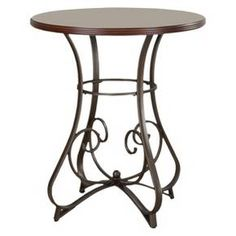 """The 3-Piece Hamilton Pub Set is sure to add interest and ample table space. The Pub Table features an interesting curve and scroll designed bottom. The Swivel Bar Stools feature a diamond shaped back and slight curved legs. Finished in """"Brushed Faux Medium Cherry"""" wood with """"Matte Pewter and Bronze"""" metal frame. Some assembly required."""