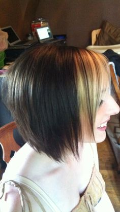 Short hair dark color with blonde piece in front  asymmetric bob