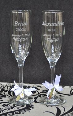 Wedding Champagne Glasses - Personalized Pair with Mr and Mrs Charms. $32.00, via Etsy.